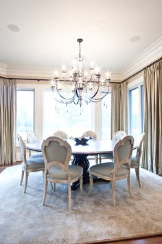 Fantastic Large Chandeliers for Pleasure: Shibby Dinning Room Design With Circle Table Feat Soft Chairs And The Large Chandeliers Surounding...