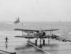 The Fairey Albacore after landing on HMS Formidable, HMS Malaya and HMS Illustrious are seen in the background. Hms Illustrious, Royal Navy Aircraft Carriers, Naval Aviator, Aviation Image, War Thunder, Aircraft Photos, Royal Air Force, Submarines, Military Aircraft