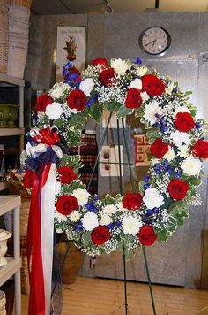 Red, white and blue funeral wreath for a veteran. I want this cuz of my birthday