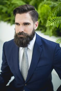 Navy suit and grey knit tie