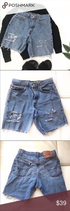 "LEVI'S 550 jeans distressed cut off shorts size 31 100% vintage feel cotton. Good condition, only flaw is hole in back pocket. (See pictures). Levi's 550 cutoff jean shorts are a denim staple! Summer Halloween costume   Waist 31"" Rise 11"" Inseam 7.5"" Levi's Shorts Jean Shorts"