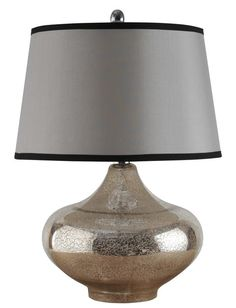 With a mercury glass base and black-trimmed shade, this table lamp will set the tone on any side table. HomeDecorators.com