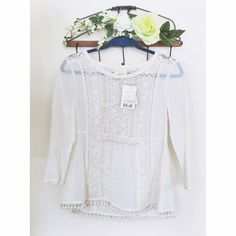 Beautiful NWT white beaded and lace detail top! Feminine and flirty white blouse by Maeve from Anthropologie! Made out of a light cotton with airy lace detail, this is versatile piece that's perfect for the office to a night out on the town.  This top is all about the understated details- both the front and back feature the beautiful lace, bead and pom pom work. Top comes with a bag of extra beads. Anthropologie Tops