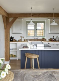 Border Oak painted kitchen with dark blue island