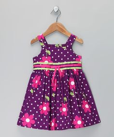 Whether little ones are tottering through the garden or on the way to brunch, this crisp cotton dress adds elegance to any occasion. Bright flowers dance across a pretty polka dot background while pink and green ribbons define the waist. Size note: Infant sizes include dress and diaper cover. Toddler sizes include dress only.