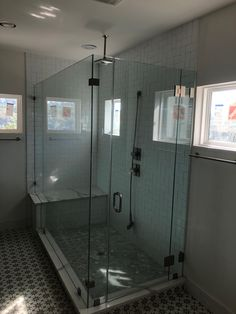 Custom Glass Shower Enclosure - 90 Degree Glass Shower Enclosure with Notched Return Panel and Glass-to-Glass Hinges. Contact Arrow Glass and Mirror, located in Austin, TX today to learn more 512-339-4888 or email sales@glassgang.com.