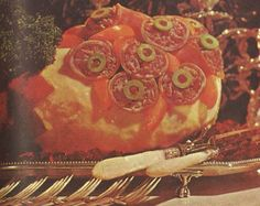 """Worst Holiday Meals/Appetizers/Recipes Ever! The Holiday Ham Chaud-Froid.""""Chaud-froid"""" is French for """"ham holding a bunch of ham mousse cornucopias"""" and surrounded by a base of sherry Jell-O! Scary Food, Gross Food, Weird Food, Bad Food, Retro Recipes, Old Recipes, Vintage Recipes, Vintage Food, Cream Cheese Ball"""