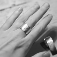 Silver ring with feather