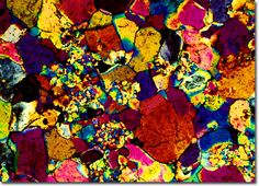 "Photograph of Amethyst under the microscope -  Amethyst is the birthstone for February and the Aquarius zodiac sign. The name amethyst derives from the Greek root amethystos, ""not intoxicated,"" which some speculate expresses the ancient folk belief that the stone protects its owner against drunkenness. More likely, the ancient Greeks were probably referring to the wine-like color of some stones."