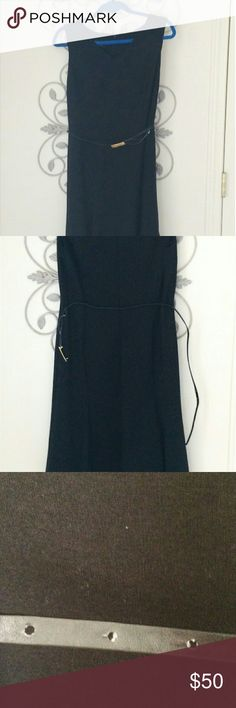Jones New York NWT Black Belt Dress Size 8 Sleeveless design that is new with tags. What if you had a little black dress that was actually comfortable? It's a shift style that you could dress up or dress down and is a soft 90% polyester 10% elastane heavy knit. There is some wear on the belt where it has been snapped and unsnapped. It's been tried on but never worn. Dry clean only. Jones New York Dresses