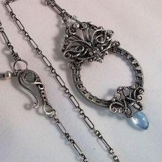 Idalis Circle Necklace Sterling Silver Blue Topaz   Kristine Schroeder Studio