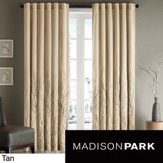 Enhance the view from your window with a set of these stylish 84-inch curtain panels. Constructed of faux silk, this panel has beautiful embroidered details of climbing branches. These panels are sold individually and are lined for your privacy.