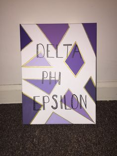 Delta Phi Epsilon. DPHIE. Canvas with purple and gold design. Made for 2016 -- Little. Big/Little Reveal 2016. Sorority crafts.