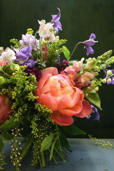 Hand tie posy of peonies, laurel, clematis, aquilegia