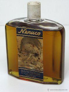 Antigua gran botella de colonia NENUCO de los años 70.
