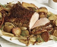 Tuscan Roast Pork with Yellow Potatoes, Fennel, and Parsnips - For this slow roast, the potatoes and vegetables are precooked so they come out perfectly tender when the pork loin is done. The rosemary, coriander, fennel seeds, and other Tuscan flavors rubbed over the pork also season the juice it releases, which creates a delicious jus for serving.  http://www.finecooking.com/recipes/tuscan-roast-pork-yellow-potatoes-fennel-parsnips.aspx