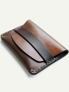 Makr Cordovan slim flap wallet. Take the hint. Downsize the crap in your pockets.