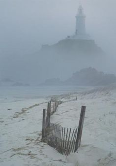 lighthouse in blowing rain.