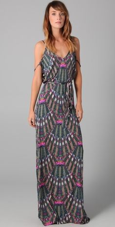 fun dress, minus the extra strappy things on the middle of her upper arm