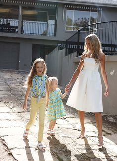 L-R: Camille wears Next Skinny Jeans (3-16yrs), Next Tie Front Blouse (3-16yrs), $21-32, and Next Corkbeds shoes (Older Girls), $21-$29; Imogen wears Next Lemon Dress (3mths-6yrs), $16.50-$18.50; Lucinda wears her own Scanlan Theodore dress.