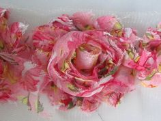 Check out this item in my Etsy shop https://www.etsy.com/listing/110645112/1-yard-shabby-fray-flowers-antique-pink