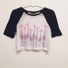 50%⬇️ Giraffe Crop Top 🌟 50% off Giraffe Crop Top! 🌟  Black & white crop top with pink/purple giraffes. The shirt is heathered jersey style. Never worn. Bought from Macy's. Size S.  📦 SHIPS FAST WITHIN 24 HOURS 📦 2KUHL Tops Crop Tops