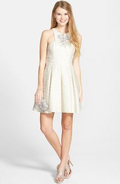 Free shipping and returns on Hailey Logan Embellished Skater Dress (Juniors) at Nordstrom.com. Sparkling stones call all eyes to a party-perfect skater dress styled with cutaway shoulders and a sheer back. Inverted pleats flare the skirt that's best spotlighted with twirls around the dance floor.