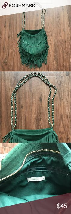 Urban Outfitters Ecote fringe suede purse gorgeous emerald green suede bag with fringe, zip closure, one interior zip pocket and one back pocket. chain can be doubled up or worn long. perfect condition has never been carried. please let me know if you have any questions! Urban Outfitters Bags