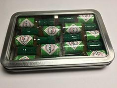 Miniature Tabasco Gift Tin. Ten 1/8 Ounce Mini Bottles of Hard to Find Green Jalapeno Tabasco Pepper Sauce in a Hinged Tin with a Clear See Through Top. TABASCO brand http://www.amazon.com/dp/B00XNK4OF6/ref=cm_sw_r_pi_dp_K3uMvb1CNM824