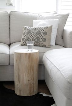 I like the Idea of a small table to put drinks on in th corner of a sectional