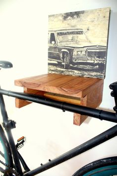 Bike rack made entirely by hand in Montreal. Made of Canary wood and movingui, there is a handy shelf inside. Very sturdy and varnished, the support is all assembled and ready to be attached to the wall.  Accept bikes with a frame of 2 inches or 5 centimeters.  width 11.75 inches or 30 centimeters depth 12 inch or 30 centimeters height 4.75 inches or 12 centimeters  weight 3.5 kg