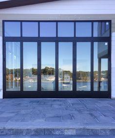 Horizontal folding door at private home in Virginia Beach, VA.  #homeinspo #entrydoor #sliding door #kitchendoor #remodel #renovation #construction #customhome