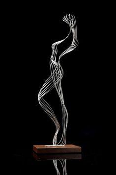 Stainless steel, with wood base #sculpture by #sculptor Martin Debenham titled: 'Improvised figure'. #MartinDebenham
