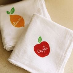Dish towels made with iron-on transfers and free downloadable fruit labels from Eat Drink Chic.