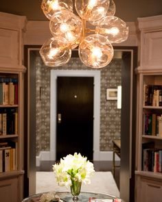 This is the foyer. I love the funky yet refined bubble chandelier, which I swiped from Carrie & Mr. Big's apartment.