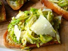 Shaved Brussels Sprouts w/ Parmesan & Truffle Oil Crostini. I have truffle oil on hand at all times....totally trying this!