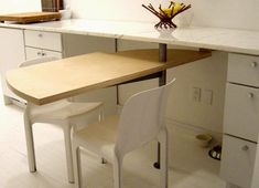 Swing out table or work surface.