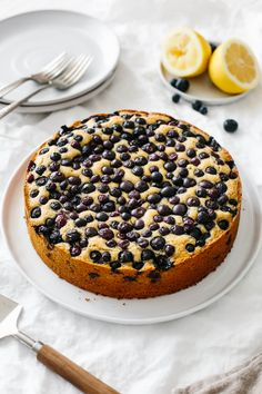 Paleo Lemon Blueberry Cake - Vegetarian Spring Recipes - Paleo Lemon Blueberry Cake is the perfect spring and summer cake recipe. It's bright, lemony and covered in a heaping amount of fresh blueberries. Paleo Dessert, Dessert Sans Gluten, Paleo Sweets, Gluten Free Desserts, Healthy Desserts, Paleo Cake Recipes, Summer Cake Recipes, Summer Cakes, Baking Recipes