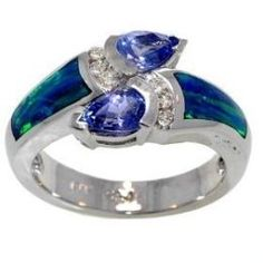 A white gold black opal ring with diamonds