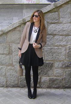 Full dark skirt, dark tights, dark shoes, fun blazer or sweater, statement necklace