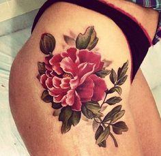 red flower thigh tattoo
