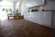 Rustic floor with modern kitchen. Reclaimed parquet oak floor, not overly sanded - two coats of Fiddes Satin Finish Hardwax Oil + modern kitchen. Reclaimed Parquet Flooring, Apartment Kitchen, Kitchen Flooring, Types Of Wood, Townhouse, Rustic, Modern, Satin Finish, Period
