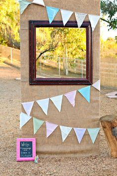 Instead of a photobooth. DIY! Next to this you could put a basket with fun accessories/props