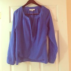 Ann Taylor Loft royal blue blouse Semi-sheer polyester blouse. Vibrant royal blue color. Button sleeves allow you to roll them if you choose. Pair with bralette or camisole underneath. Deep V. Can fit M or L. LOFT Tops Blouses