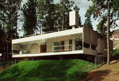 Galería de Casa en Aldeia da Serra / MMBB Arquitetos + SPBR Arquitetos Concrete Water Tank House  