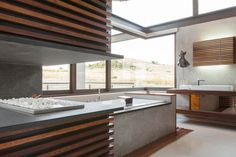 Contemporary bathroom with a fireplace -- Designed by Nico van der Meulen Architecture.