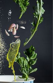 Recipe photography concept The raw ingredients rest in weightlessnes. They are properly proportioned falling into the vessel where they are further processed. The image serves a foretaste not only of the dish but also of its preparation. The look...