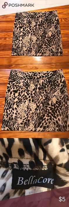 """Leopard print mini skirt Short skirt with partial zipper in back. I'm 5""""7 and it falls just above my knees. Bella Core Skirts Mini"""