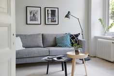 Bright living room with black,white and wooden accents