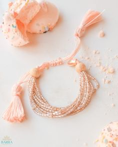 Inspired by the delicate and airy dessert, Meringue is a handmade multi-strand bracelet made with fine glass seed beads, 22k gold plated beads and an adjustable sliding knot.